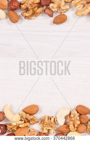 Frame Of Various Nuts And Almonds, Concept Of Healthy Nutrition And Lifestyle, Place For Text Or Ins
