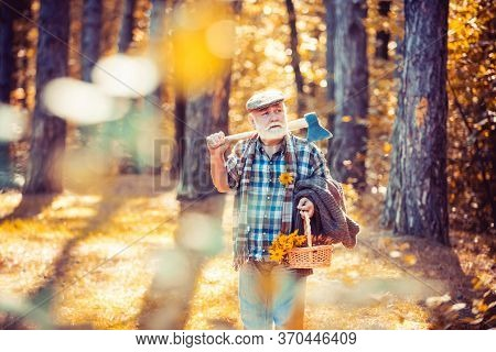 Sunny Weather. Portrait Of Aged Man With Beard. Mature Man With Beard In Hat. Outdoor Portrait. Wood