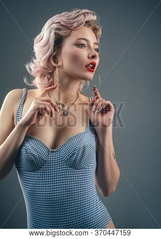 Gold Hoop Earrings. Retro Model With Pin Up Make Up Showing Round Earrings