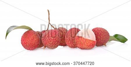 A Litchi And Green Leaves Isolated On White Background