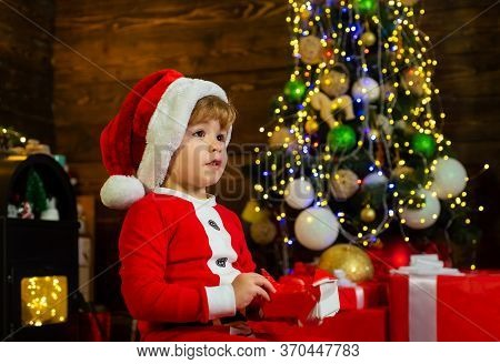 Christmas Children. Christmas Child Holding A Red Gift Box. Christmas Kids - Happiness Concept. Chee