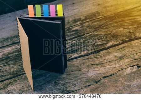 Diary With Colored Tabs. Five Colorful Bookmarks With Notebook , Closeup Of Colour Tabs For Bookmark
