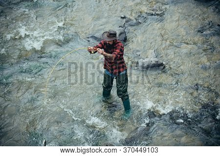 Portrait Of Cheerful Man Fishing. Fisher Masculine Hobby. Sports Fishing. Bearded Fisher In Water. P
