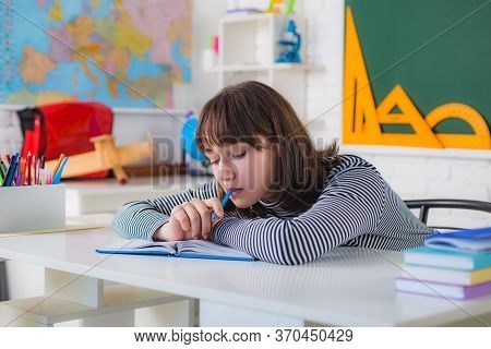 Teenager Is Writing On The White Board. School Student. Portrait Of A Female Student In University.