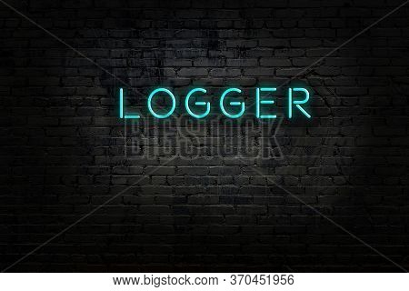 Night View Of Neon Sign On Brick Wall With Inscription Logger