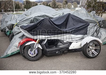 The Motorcycle Is Covered With An Awning From The Rain. Workshop For Electric Vehicles. Parking Bike