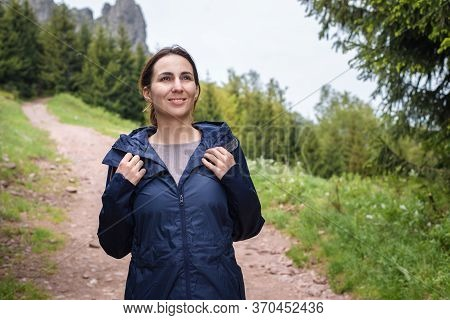 Beautiful Woman Smiling In Nature. Happy People Lifestyle. Woman Smiling While Hiking In Nature. Nat