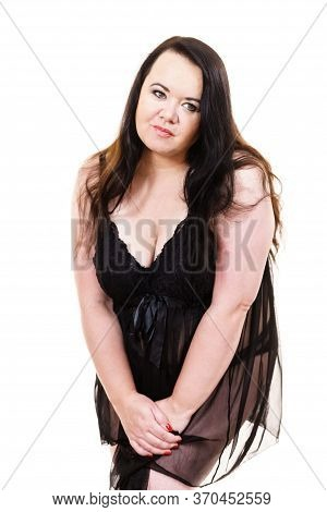Plus Size Fat Woman Wearing Black Lace Lingerie Babydoll Showing Her Chest Breasts. Bosom Concept.