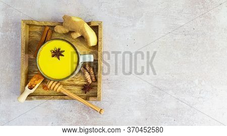 Wooden Tray With Golden Ayurveda Milk And Ingredients: Turmeric, Cinnamon, Honey, And Ginger With Co