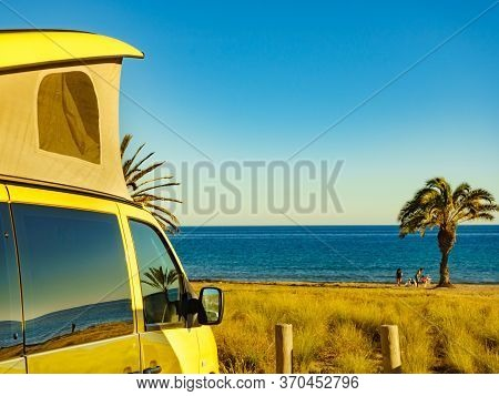 Camper Van With Tent On Roof Camping On Mediterranean Coast With Palm Trees In Spain. Percheles Beac