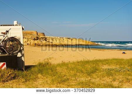 Camper Car With Bike On Rack Camping On Sea. Beach El Playazo, Cabo De Gata Nijar, Province Almer