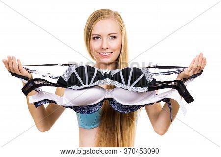 Woman Choosing Bra To Wear