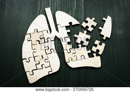 Human Lung From Puzzles As Symbol Of Lung Cancer Or Respiratory Illness.