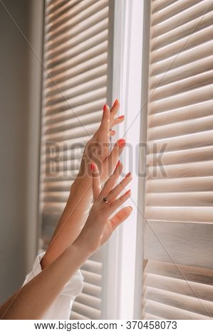 Female Hands On A Background Of A Window. Woman Waking Up Stretching In Bed At Home. Early Out Morni