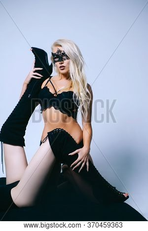 Beautiful Young Woman In Black Mysterious Lace Mask. Passion. Fashion Vogue Style Studio Portrait. Y