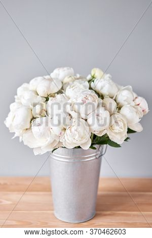 White Odile Peonies In A Metal Vase. Beautiful Peony Flower For Catalog Or Online Store. Floral Shop