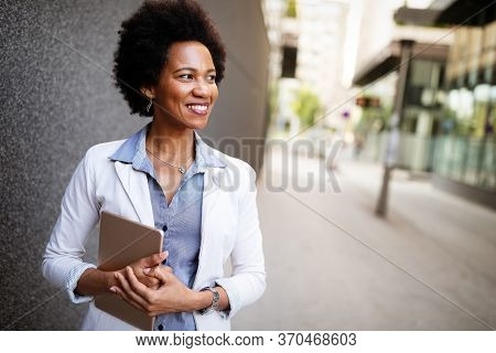 Beautiful Happy Professional Business Woman Smiling Happy With Tablet Outdoor