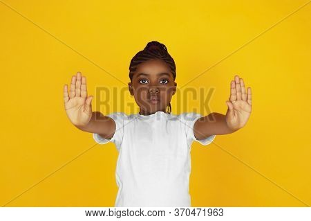 Rejecting, Stopping. Little African-american Girls Portrait On Yellow Studio Background. Cheerful, S