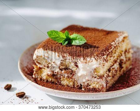 Perfect Homemade Tiramisu Cake With Fresh Mint. Tiramisu Portion On Pink Plate Over White Marble Bac