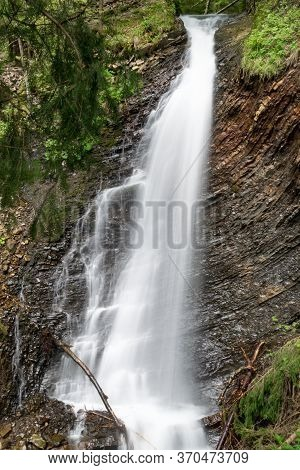 Waterfall In The Carpathian Mountains, Ukraine. Cascading Water Flow With A Long Exposure