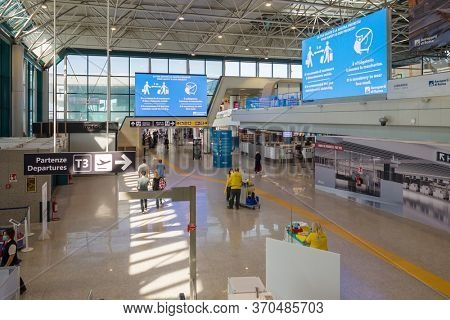 Rome, Italy - june 3, 2020: Departure terminal 3 in Rome Fiumicino Airport at the first day after Covid 19 pandemic lockdown in Italy. New pandemic rules on information boards