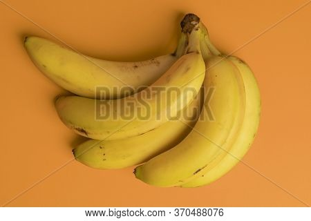 Bunch Of Ripe Bananas On A Bright Background. Spotted Overripe Tropical Fruits. View From Above. Abs