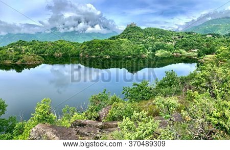 Italian lake and middle age castle. Lago Sirio, Piemonte, Italy.