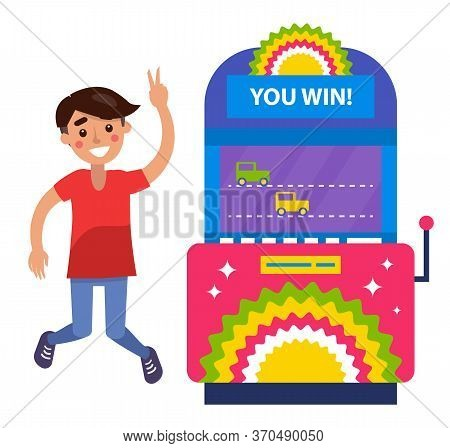 Guy With Brown Hair In Red T-shirt And Jeans Playing Slot Machines. Smiling Boy Winning Money In Cas