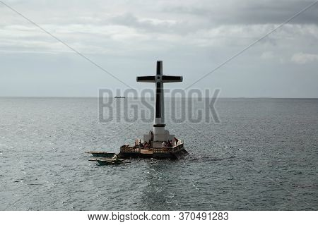 Camiguin, Ph - February 3 - Sunken Cemetery Cross Monument On February 3, 2013 In Camiguin, Philippi