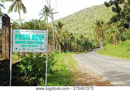 Camiguin, Ph - February 3 - Pasil Reef Marine Sanctuary Sign And Road On February 3, 2013 In Camigui