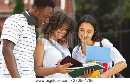 Cheerful University Friends Studying Together Outdoors, Standing With Workbooks In College Campus, C