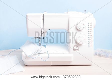 White Sewing Machine For Sewing Protective Reusable Masks, Sew A Face Mask From Fabric At Home, Blue