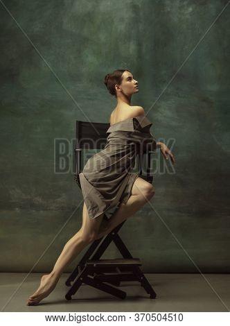 Beautiful Portrait, Elegance. Graceful Classic Ballerina Dancing, Posing Isolated On Dark Studio Bac