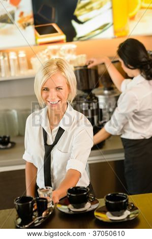 Waitress serving coffee cups making espresso woman cafe bar working