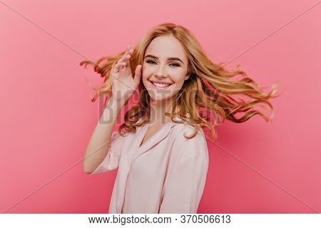 Close-up Portrait Of Happy Young Woman With Beautiful Blonde Hair Isolated On Pink Background. Photo