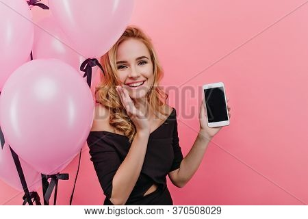 Pretty Girl Holding New Phone And Smiling. Fashionable Blonde Woman Get A Smartphone As A Birthday G