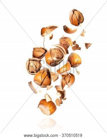 Crushed Hazelnuts Frozen In The Air On A White Background
