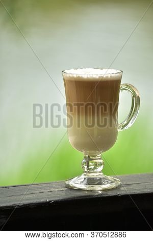 Hot Coffee On The Summer Terrace. Warm Weather. Cup Of Latte In The Summer. Cappuccino Or Latte In A