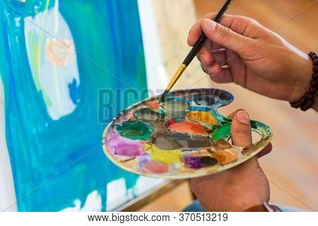 Artist With Palette, Artist At Work, Young Artist Painting A Picture