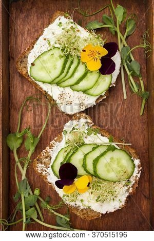 Healthy Sandwiches With Cream Cheese , Microgreens, Edible Flowers And  Cucumber. Healthy Eating, Di