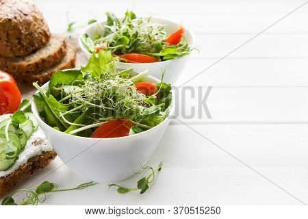 Micro Greens Salad With Tomatoes, Cucumber,  Leaves Mix Salad .healthy Food Background. Vegan Food,