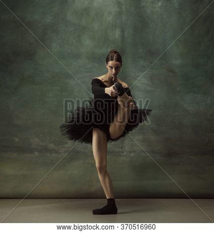 Beautiful Portrait. Graceful Classic Ballerina Dancing, Posing Isolated On Dark Studio Background. E