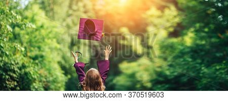Photo From Back Graduate Graduated Little Girl In Cap Throw It Up In The Sky, Happy Of Ending, Viole