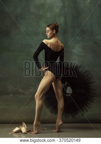 Confident. Graceful Classic Ballerina Dancing, Posing Isolated On Dark Studio Background. Elegance B