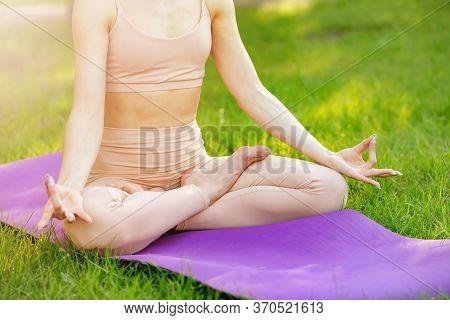 Woman Do Yoga Relax Outdoor, Enjoying Meditation In The Park. Balance