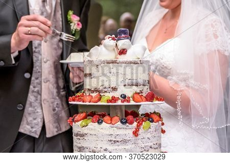 Groom And Bride Marriage Cutting The Delicious Fruity Wedding Cake Together Colorful Fruits