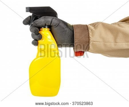 Worker Hand In Black Protective Glove And Brown Uniform Holding Bright Yellow Plastic Spray Bottle I