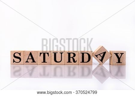 The Word Saturday On Wooden Cubes. Weekday Concept.