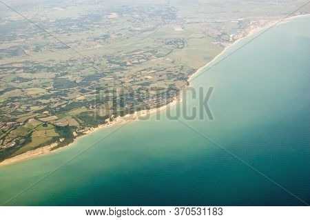 Aerial View Of The Coast At Sussex With Fairlight In The Foreground Stretching To Winchelsea And Cam