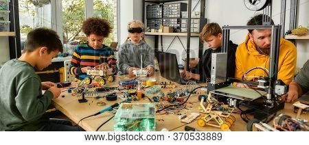 Young Technicians Building Robots And Vehicles, Using Soldering Iron To Join Chips And Wires, Testin